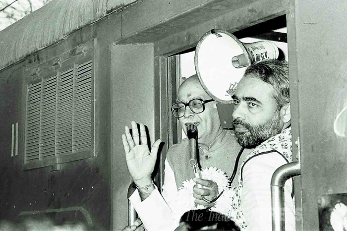 L K Advani and Narendra Modi after the Riots of 92 in Surat. (Express archive photo)